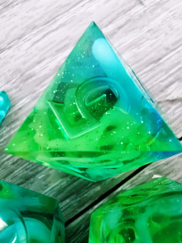 green teal shimmery dice